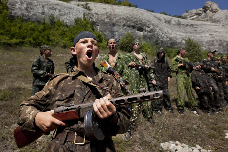 The dress code is camouflage for children 8-16, who attend a camp in the mountains of Eski-Kermen near Bakhchisaray, run by the Crimean Cossacks, who call themselves a pro-Russian nationalist group. Campers receive lessons in discipline and military training. Cossackdom youth camp.Ukraine. Photo by Gerd Ludwig