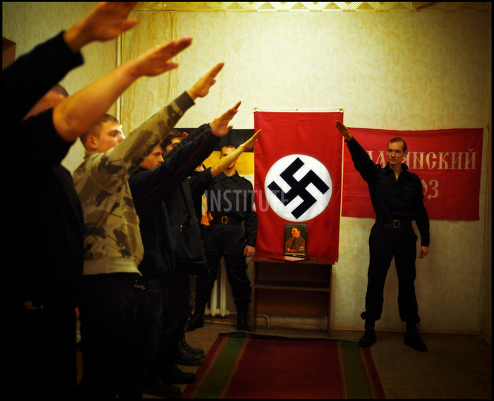Meeting of the Slavic Union (translation of « Slavianski Soyz »  aka SS) in Saint Petersburg. The new militants have to take an oath to the organization, a knee on the ground, facing Hitler's portrait, and a Nazi flag. Guillaume Herbaut