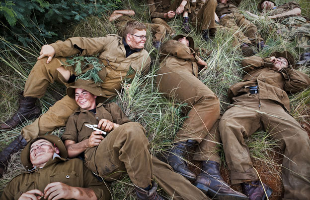 Young white Afrikaners lay around at a defence camp. Photo by Ilvy Njiokiktjien