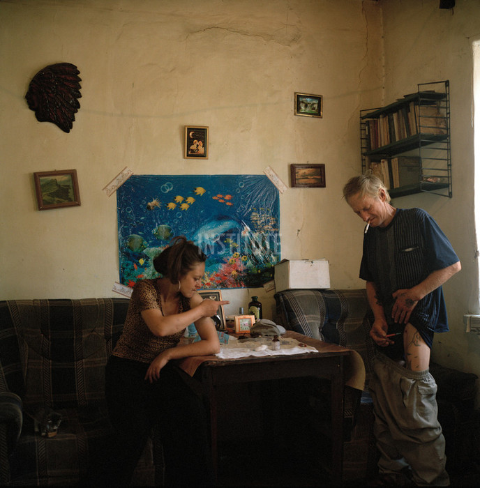 Liza and Vitya shooting up heroin at home. Liza shares a room with an HIV positive tattoo artist and heroin addict Vitya. Osh, Kyrgyzstan. 2007. Photo by Rena Effendi