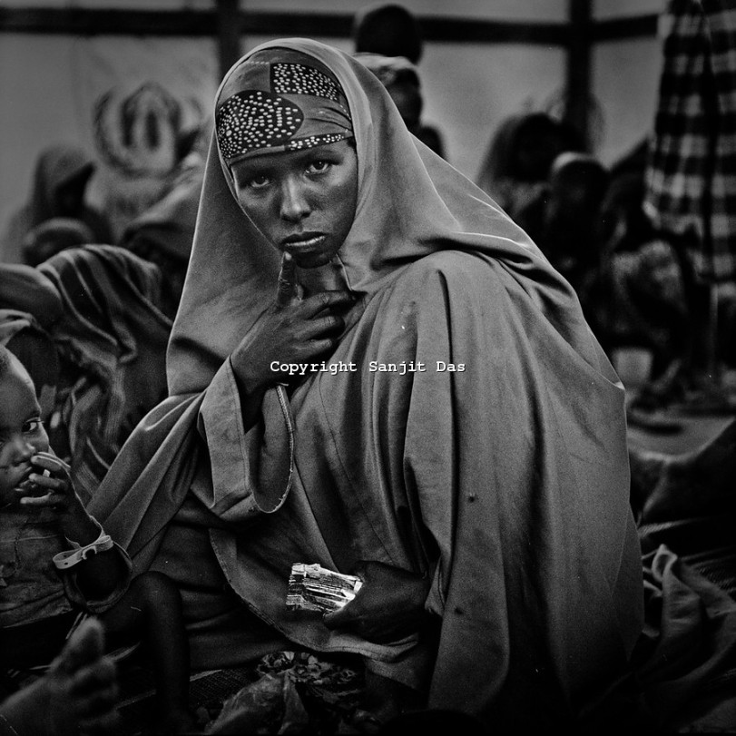 A Somali refugee seen with her child inside a stabilisation centre at the IFO-1 camp part in the Dadaab refugee camp in northeastern Kenya. Hundreds of thousands of refugees are fleeing lands in Somalia due to severe drought and arriving in what has become the world's largest refugee camp. Photo by Sanjit Das