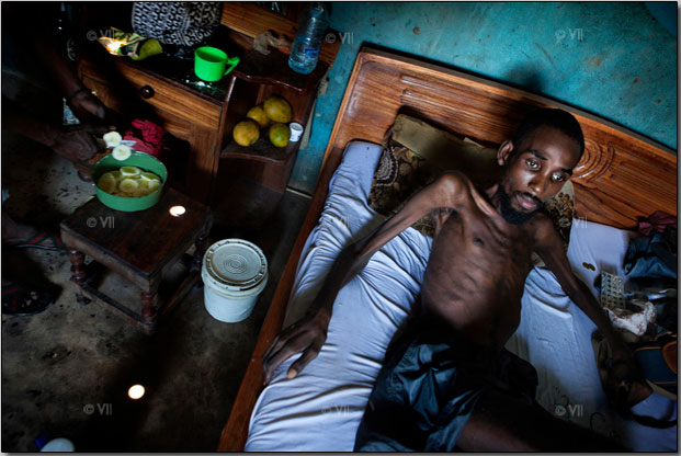 A bedridden man is seen in Dar es Salaam, where drug use is one of the main sources of H.I.V. transmission. Photo by Marcus Bleasdale