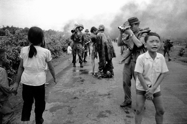 "David Burnett took this photo of the aftermath of a napalm attack in Vietnam in 1972. While he was loading his camera there, fellow photographer Nick Ut captured the famous ""napalm girl"" image."