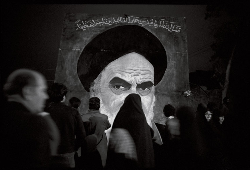 It was hard to walk anywhere and not see signs of the Revolution. Here, a makeshift wall painting, with a portrait of Ayatollah Khomeini, in Tehran, February 1979.  Photo by David Burnett
