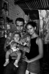 Giovanni Morales (32) and his wife Isamar Orellana (20) and their new born Grace (3 months). Giovanni is a gang member of the Mara Salvatrucha. He has been in prison four times and started to realize that this was not the life he wanted. He is now fighting to be accepted by society and live a normal life. Photo by Kadir van Lohuizen