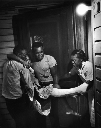 Accident case is brought to Maude's door one night. Annabelle Fuller was seriously cut in an auto accident and Maude had given her first aid. Now the girl returns to have her dressings changed. Photo by W. Eugene Smith