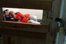Silvia Rodas, 25, lies in bed with her girlfriend Yesica in their shared cell in Bahia Blanca, 350 miles (563 km) south of the capital Buenos Aires, Oct. 16, 2012. Rodas was convicted of robbery and attempted homicide at the age of 19 and has since done stints in all the prisons in Buenos Aires province, being moved around due to bad conduct. She ended up in Bahia Blanca, the last prison that would accept her. Her daughter Anahi was three years old when she was convicted and lived in prison with her until she was five. Photo by Paula Nelson