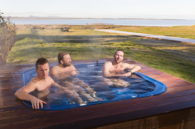 Serial entrepreneur, financial investor and businessman Skúli Mogensen (right) and his training partners relax after an early morning swim outside his oceanfront home in Reykjavik, Iceland. Considered to be the richest person in Iceland, Mogensen's successful career began by building companies in the telecom and technology sector in Iceland, Europe and North America. Photo by Lauren Greenfield