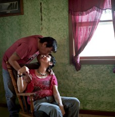 Myrna Whiteshield, 47 and her boyfriend Richard Jackson, 46. at their friend's home where they currently reside. Myrna lost her own home 10 years ago to a fire accident and has been homeless ever since, living out of various households on the reservation. Photo  by Rena Effendi